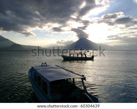 sunset at atitlan lake - stock photo
