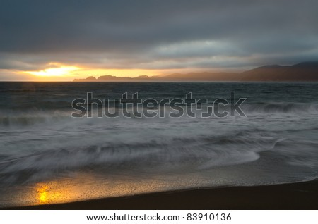 Sunset at Baker Beach with Marin Headlands in the background - stock photo