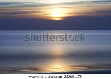 Sunset at beach in France - stock photo