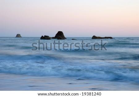 Sunset at Benson beach, Cape Disappointment State park, Washington - stock photo