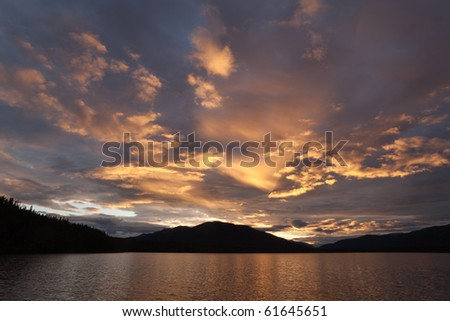 Sunset at Big Salmon Lake, Yukon Territory, Canada - stock photo