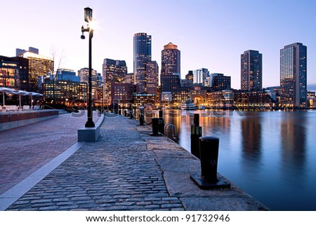 Sunset at Boston Harbor and Financial District in Boston, Massachusetts. - stock photo