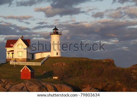 "Sunset at Cape Neddick ""The Nubble"" Lighthouse (built in 1879) - stock photo"