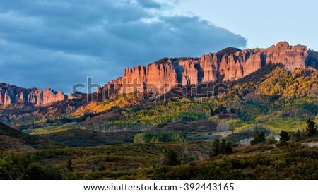 Sunset at Cimarron Ridge - Autumn sunset view of rugged Cimarron Ridge South, 11,526 ft (3,513 m), part of San Juan Mountains, seen from Owl Creek Pass Road, near Ridgeway, Colorado, USA. - stock photo