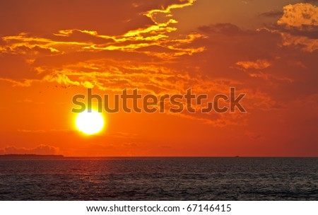 sunset at coast of the sea - stock photo
