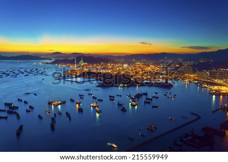 Sunset at container terminal in Hong Kong - stock photo