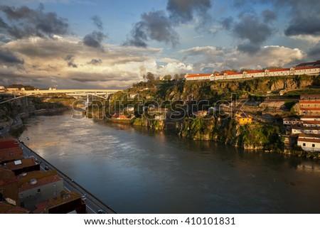 Sunset at Douro River between Vila Nova de Gaia and Porto in Portugal - stock photo