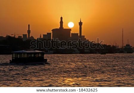 Sunset at Dubai Creek, United Arabian Emirates UAE - stock photo