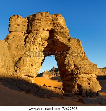 Sunset at Forzhaga Arch - Huge natural rock arch - Akakus (Acacus) Mountains, Sahara, Libya - stock photo