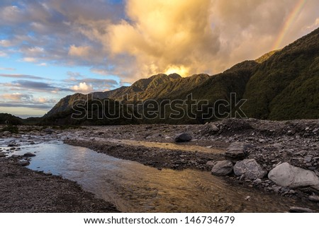 Sunset at fox glacier in New Zealand - stock photo