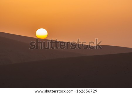 sunset at gobi desert,china - stock photo
