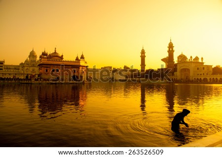 Sunset at Golden Temple in Amritsar, Punjab, India. - stock photo