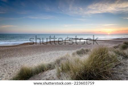 Sunset at Hengistbury Head near Bournemouth in Dorset - stock photo