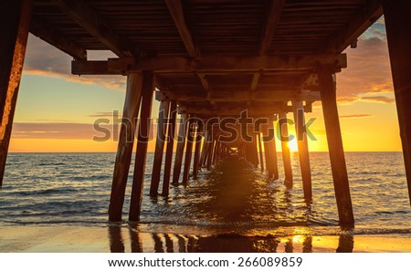 Sunset at Henley Beach - view from under the pier - stock photo