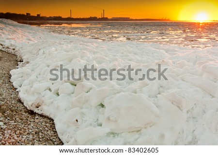 Sunset at ice cold sea