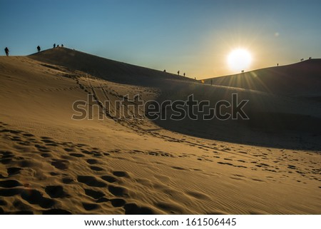 sunset at kobi desert,china - stock photo