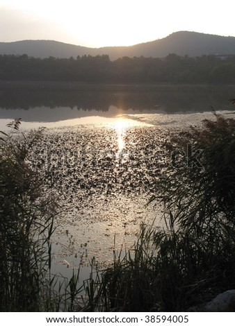 sunset at lake during fall season - stock photo