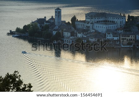 Sunset at lake Orta with the island of San Giulio, Italy
