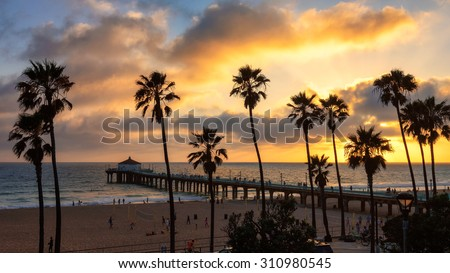Sunset at Manhattan Beach and Pier in Southern California, Los Angeles. - stock photo