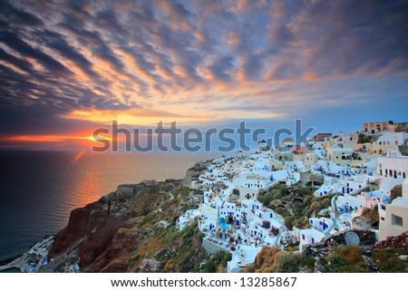 Sunset at Oia village on Santorini island, Greece - stock photo