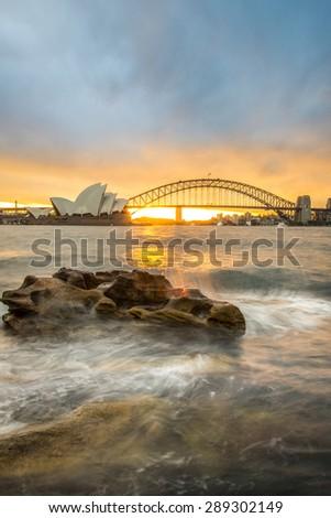 Sunset at Opera house and Harbour bridge, Sydney, Australia. - stock photo