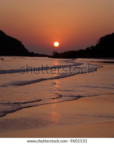 Sunset at Palolem beach, state of Goa, India - stock photo