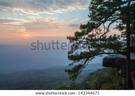 Sunset at Pha Lom Sak cliff in Phu Kradueng in Loei province, Thailand - stock photo