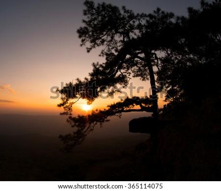 Sunset at Pha Lomsak Phu Kradueng National Park, Loei, Thailand - stock photo