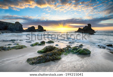 Sunset at Porthcothan Bay, a sandy cove on the north coast of Cornwall between Newquay and Padstow - stock photo