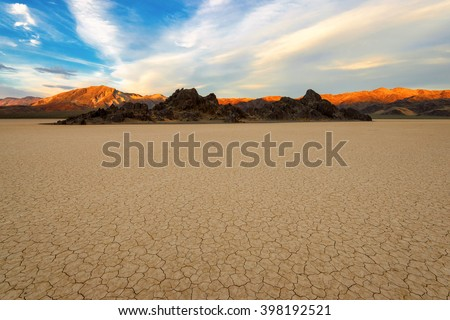 Sunset at Racetrack Playa in Death Valley National Park - stock photo