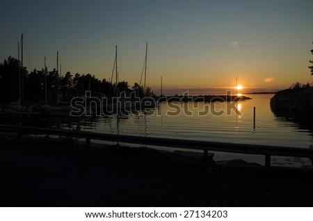 Sunset at Ristikari fishing harbor - stock photo