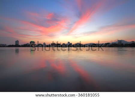 Sunset at River. Taken using Slow Shutter Speed. Long Exposure. Motion Blur and Soft Focus due to Long Exposure. Vibrant Colors - stock photo