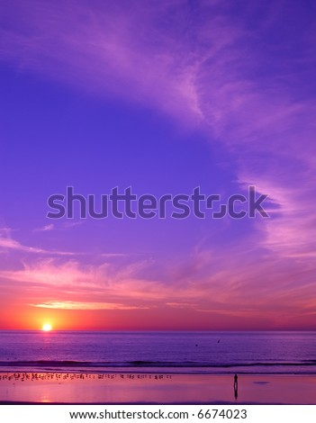 Sunset at San Diego beach with a peaceful man and birds - stock photo