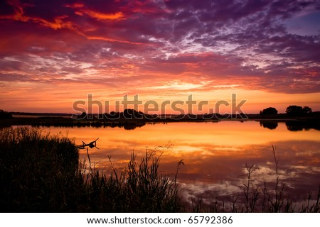 Sunset at Sawhill Ponds, Boulder, Colorado - looking west over the Rockies - stock photo