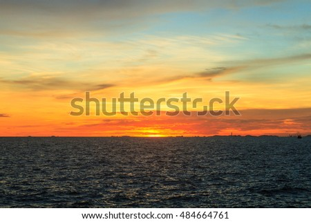 Sunset at sea during twilight time with vivid colored and dramatic sky, Thailand.