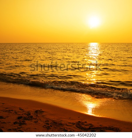 Sunset at sea, may be used as background - stock photo