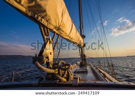 sunset at sea on aboard the Yacht Sailing - stock photo