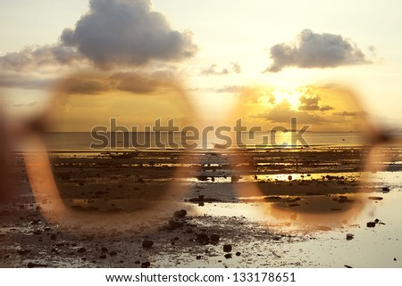 Sunset at sea, the boat - stock photo