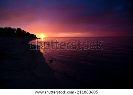 sunset at sea. variety of colors and hues of the rising sun - stock photo