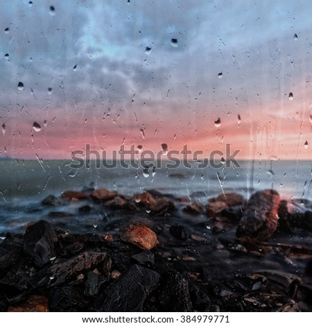 Sunset at Sea View from the window. Storm. Seascape  behind the glass, rain - stock photo