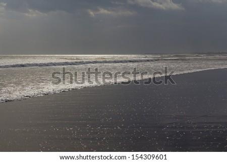 Sunset at Seminyak Beach on Bali �¢?? Indonesia - stock photo