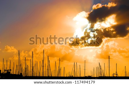 sunset at the Alghero harbor - stock photo