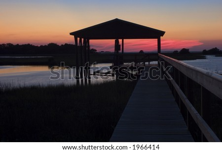 Sunset at the boat house on Cedar Key, Florida. - stock photo