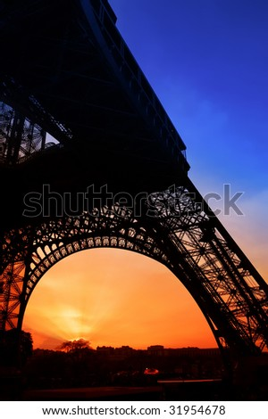 Sunset at the Eiffel tower in Paris - stock photo