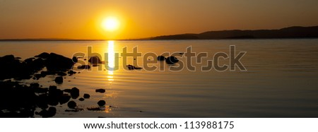 Sunset at the lake - stock photo