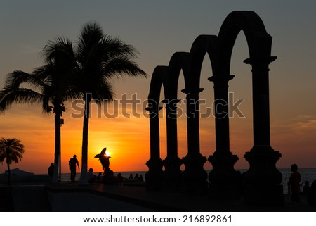 sunset at the Los Arcos Puerto Vallarta - stock photo