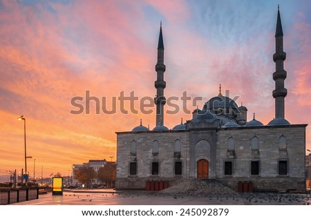 Sunset at the New Mosque (Turkish Yeni Valide Camii) historic architecture in Istanbul, Turkey - stock photo