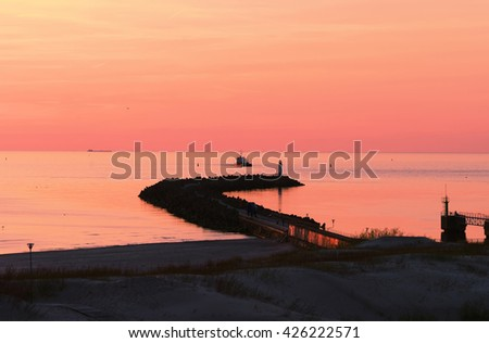Sunset at the pier in Baltic Sea in Ventspils. Ventspils a city in the Courland region of Latvia. Latvia is one of the Baltic countries - stock photo