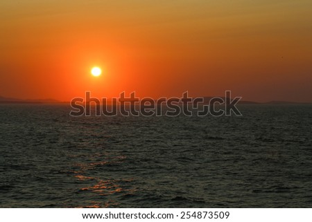 Sunset at the Portara Gate of the Apollo Temple in Naxos island - stock photo