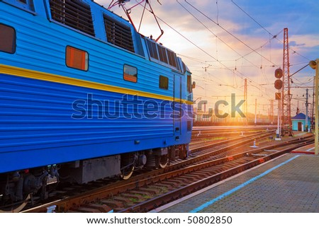 Sunset at the railway station - stock photo